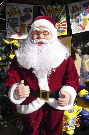giver: Christmas decoration objects for sale in a shop including lights and a santa doll. Stock Photo