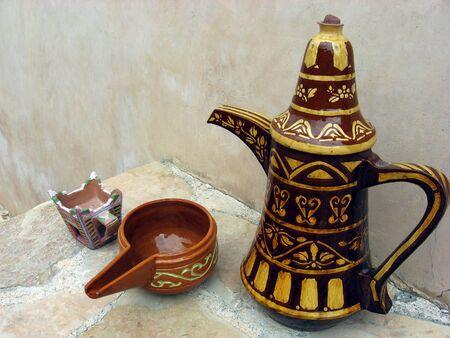 arabic coffee: A finjan for making Arabic coffee and cup in Al Hazm Fort in Oman