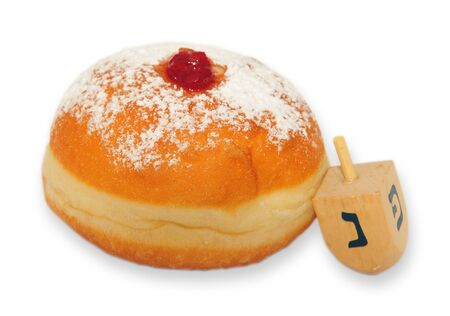 judaical: A doughnut and spinning top on white background Stock Photo