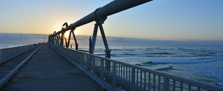 gold coast: Sunset over the Gold Coast Pier at the Spit in Queensland Australia
