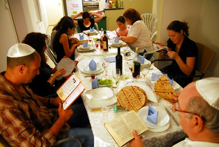 JERUSALEM - APRIL 20: Jewish family are reading the traditional Hagaddah seder ritual on the Jewish holiday of Passover on April 20 2008 in Jerusalem, Israel.