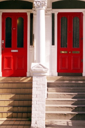 Twin red house doors in London, UK. Stock Photo