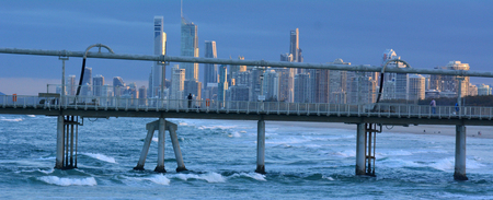 surfers paradise: Sunset over the Gold Coast Pier at the Spit while Surfers Paradise skyline is in the background in Queensland Australia Stock Photo
