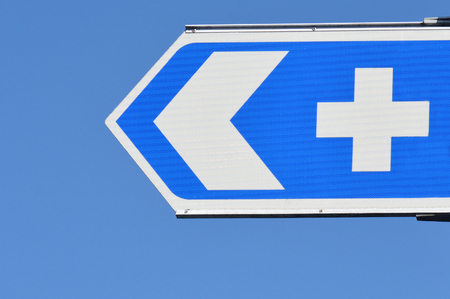 forewarning: Hospital road sign against blue sky.concept photo of health and medical care. Stock Photo