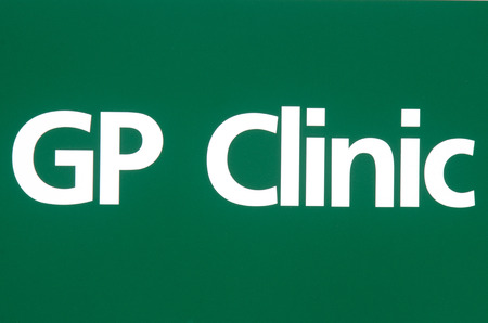 gp: GP clinic sign on green background.