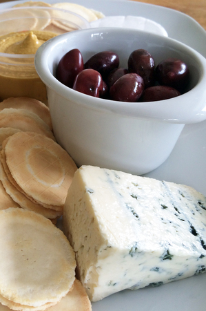 appetiser: Kalamata olives served as appetisers with blue vein cheese ,crackers and humus.