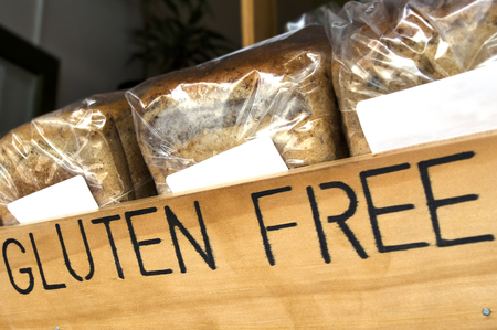 gluten free: Gluten Free loaf of breads on display in a health food shop that sells Gluten Free food. Stock Photo