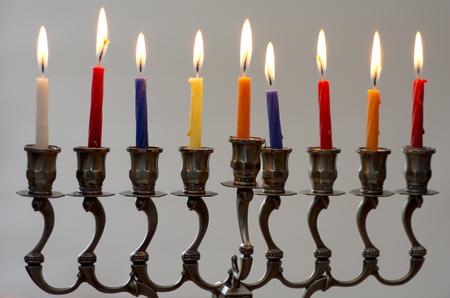 hanukka: A fully lit Hanukkah menorah during the Jewish holiday of Hanukkah. close up