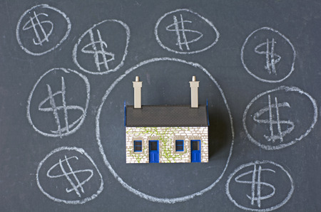 housing industry: House bubble boom presentation on chalkboard. Concept photo of Real estate market bubble , booming, money,price, rent, grid, home, house, housing, industry and subprime mortgage crisis. (Copy Space) Stock Photo