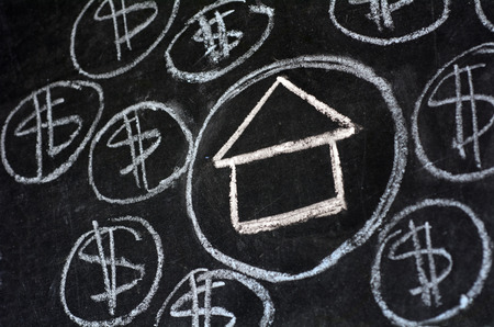 subprime mortgage crisis: House bubble boom presentation on chalkboard. Concept photo of Real estate market bubble , booming, money,price, grid, rent,home, house, housing, industry and subprime mortgage crisis. (Copy Space)