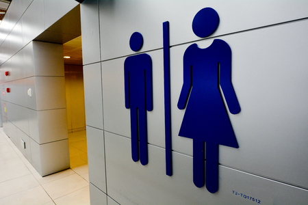 Men and women toilet signs on a wall. Stock Photo