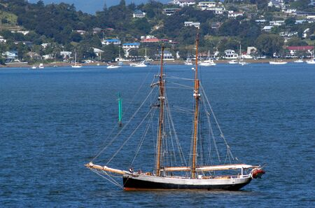 aotearoa: Traditional British Sea ship on the shore of Russell New Zealand for the celebration of Waitangi Day. Stock Photo