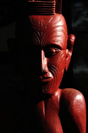 aotearoa: Traditional Maori wall carvings in a Marae (meeting house) New Zealand.