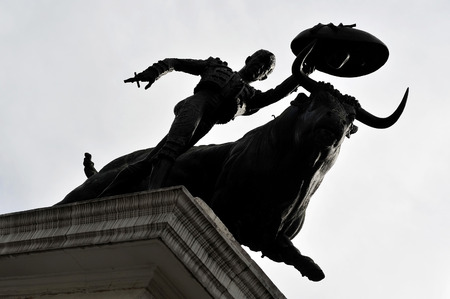 plaza de toros: A statue of a Matador and a bull engage in a standoff before engaging in a bullfight battle on March 1, 2010 in Mexico city, Mexico.