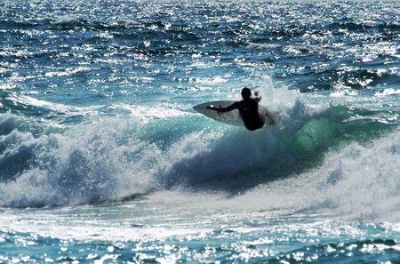 Wave surfer surfing wave at sea. 스톡 콘텐츠