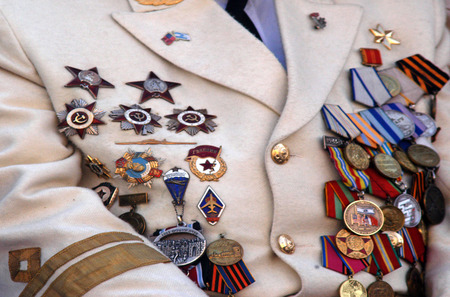cross armed: Many war military medals on a army uniform. Editorial