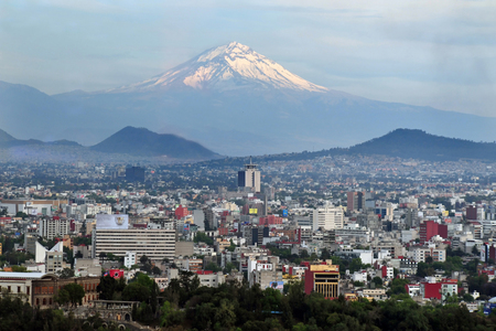 city center: A view of Popocatépetl Volcano Mountain Behind Mexico City.