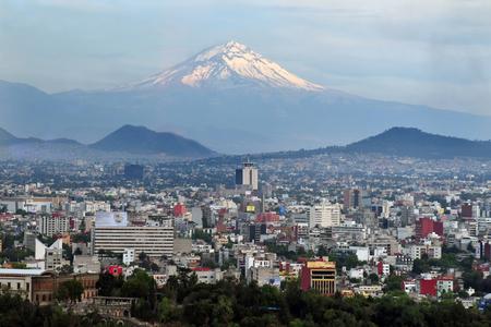 city life: A view of Popocatépetl Volcano Mountain Behind Mexico City.