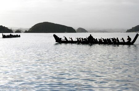 maori: A traditional New Zealand Maori waka boat on the sea in the Bay of islands, New Zealand.