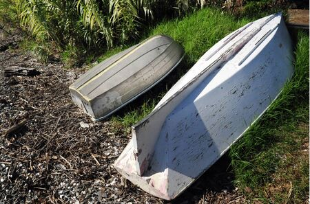 dingy: Dingy boats rest on shore of Mangonui Harbor, Northland, New Zealand.
