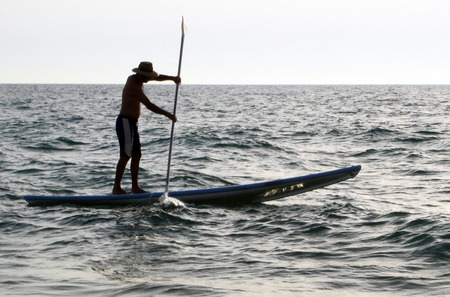 A man rids a Hasake. Hasake is the Middle East SUP Surfing Sports. Stock Photo