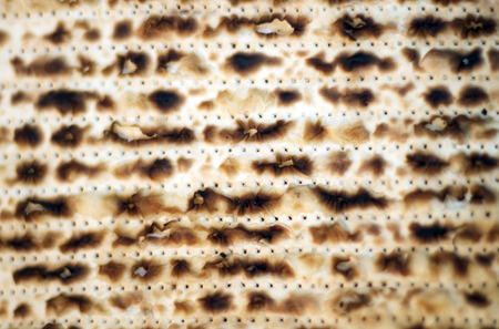 judaical: A close up images of matzah unleavened bread which is eaten during the Jewish holiday of Passover.