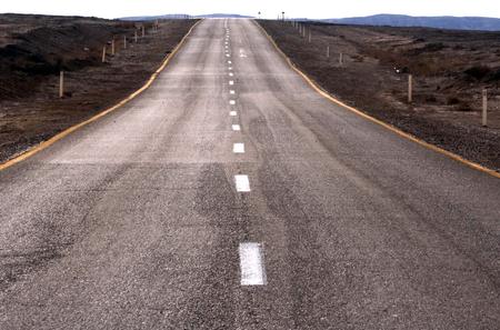 arava: Long straight tarmac road heading into the desert of Arava valley, Israel.