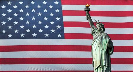 enlightening: Statue of Liberty with American Flag in the background Stock Photo