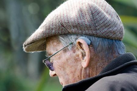 Elderly man with hearing aid. Rafael Ben-Ari/Chameleons Eye