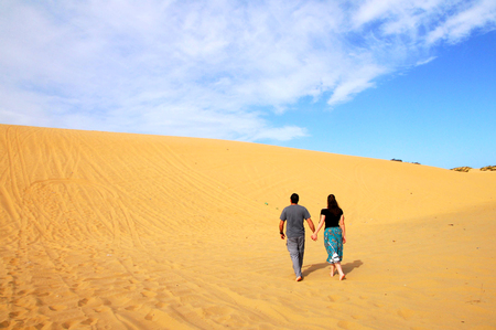 ashdod: A couple climbs to the top of the Great Sand Dune near Ashdod, Israel.