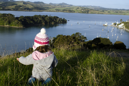 inlet bay: A child travel outdoor near Manganui town Northland, New Zealand.
