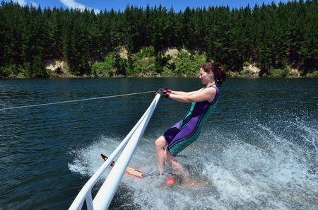 water skier: A water skier woman water skiing on a lake.