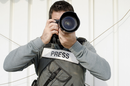 photojournalist: A press photographer takes photos with a professional camera