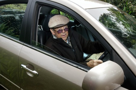 80 s: A very old man with a valid driving license drives his car. Stock Photo
