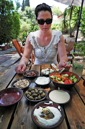 cornerstone: Traditional Israeli breakfast in a restaurant in Rosh Pinna town located in the Upper Galilee on the Northern District of Israel.