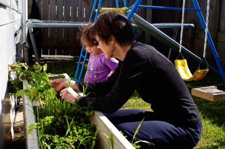 grand daughter: Senior woman explain to her grand daughter how plants grows.