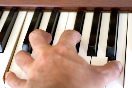 piano player: Piano player hand plays the piano. Stock Photo