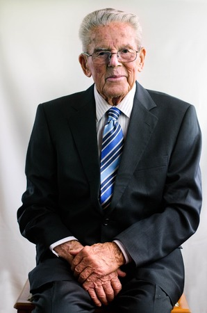 90s: Portrait of happy old man wearing a suit in his 90s. Stock Photo