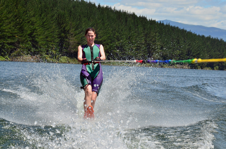 water skiing: A water skier woman water skiing on a lake.