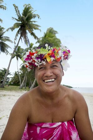 tahitian: Portrait of Polynesian Pacific Island Tahitian mature male wearing exotic flowers top bouquet smile out side his home garden in Aitutaki lagoon Cook Islands.