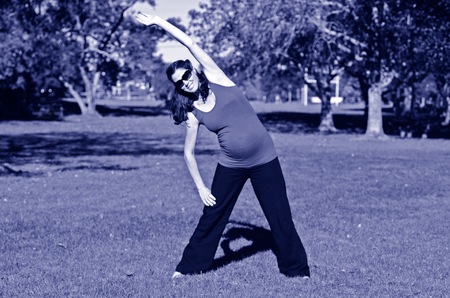 pregnant woman yoga: Pregnant woman yoga exercise during pregnancy outdoor at the park. Concept photo of women healthy life style and health care. copyspace Stock Photo