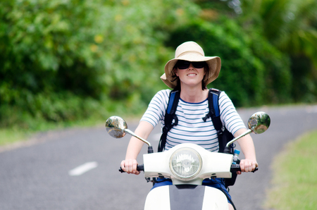 drivers license: AITUTAKI - SEP 20:Tourist woman drives hired motorbike on Sep 20 2013.Its one of the must popular activity in the Island but Cook Islands Drivers License is required to operate a motorized rental. Editorial