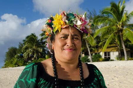 Portrait of mature Polynesian Pacific Islander woman on tropical beach with palm trees in the background. Photo have MR