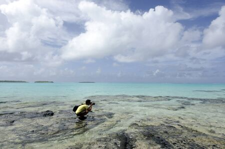 Travel photographer photographing and explores the nature and landscape of Aitutaki Lagoon Cook Islands