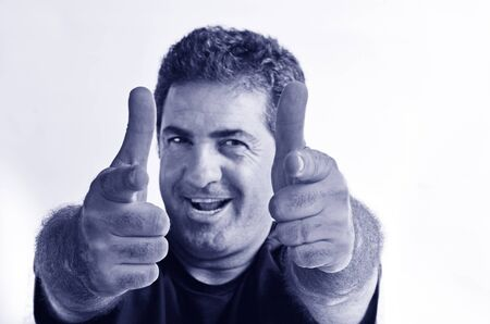 coolness: Happy young mature man showing thumbs up.Copy space on white background.real people.Concept photo of success, approval, youth, coolness, positivity,happiness,agreement,confident,friendly,achievement. (BW) Stock Photo