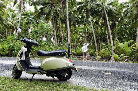 drivers license: AITUTAKI - SEP 20:Tourist man explore the nature with motorbike on Sep 20 2013.Its one of the must popular activity in the Island but Cook Islands Drivers License is required for motorized rental. Stock Photo
