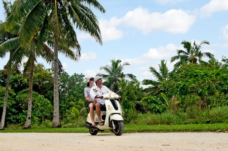 drivers license: AITUTAKI - SEP 20:Tourists travel by motorbike on Sep 20 2013.Its one of the must popular activity in the Island but Cook Islands Drivers License is required to operate a motorized rental.