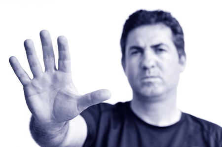 objection: Upset mature man show stop sign with his palm. Copy space on white background.real people.Concept photo of dislike, displeasure,disagreement, disapprove, refusal, refuse, rejection, stop, no (BW) Stock Photo