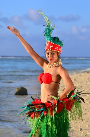 tahitian: Portrait of Polynesian Pacific Island Tahitian female dancer in colorful costume dancing on tropical beach. (Photo have MR)