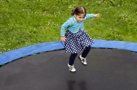 about age: AUCKLAND OCT 08:Girl(Talya Ben-Ari age 3) jumps on trampoline on Oct 2010.Statistics show that about 80,000 children were treated in hospital emergency rooms for trampoline-related injuries every year